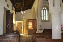 St Nicholas, Tackley - looking down south aisle towards kitchen pod and toilet at west end